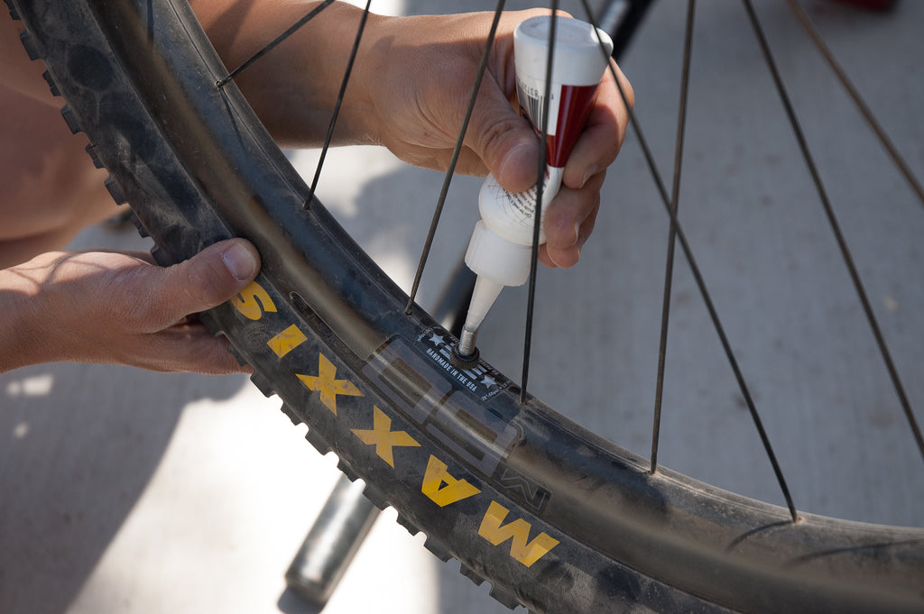 cycling bicycle tubeless tire sealant installation
