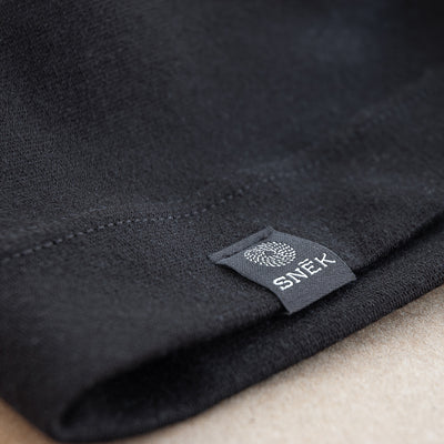 snek cycling merino beanie label