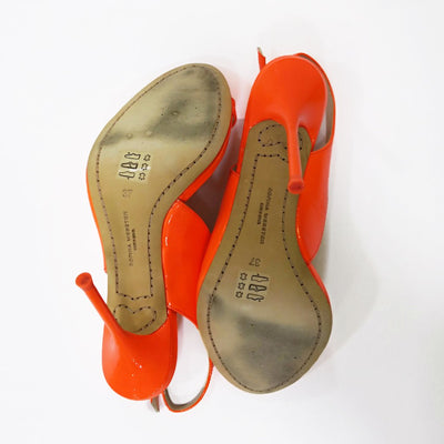 """Claudie Meadow"" Orange asymmetrical pumps"