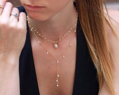 Dainty 14k gold filled lariat necklace with natural freshwater pearls .