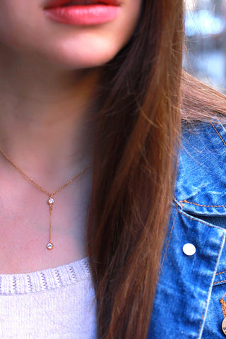 Floating created diamond lariat necklace