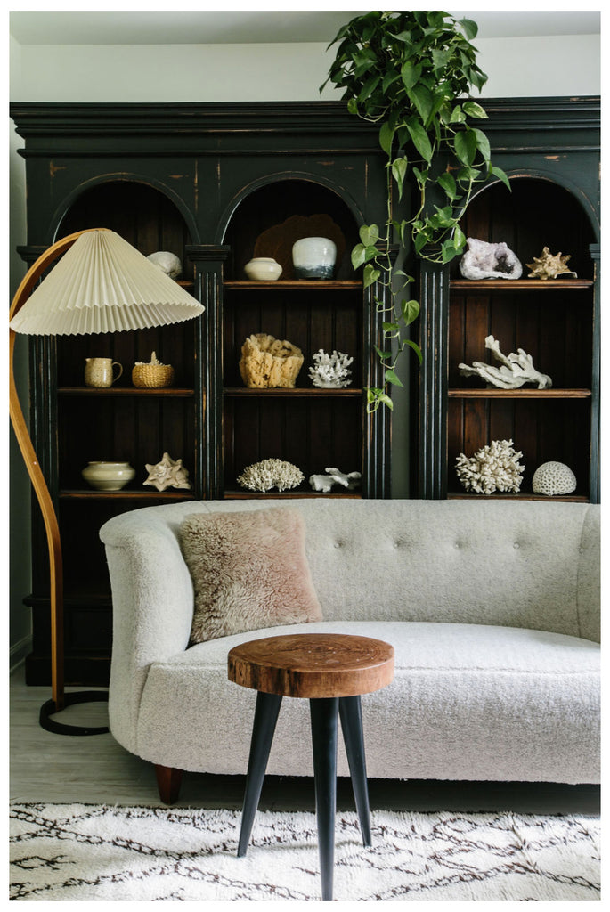 viggo boesen banana settee upholstered in shearling, mads caprani lamp, and moroccan beni ourain rug. How to style your home like an interior designer
