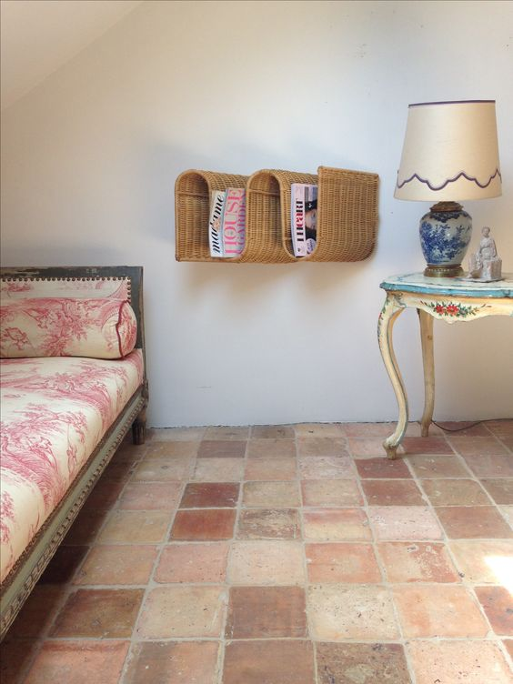 spring time decor can mean renewing the floors. try terracotta tiles and toile bed sheets for the decorating win.