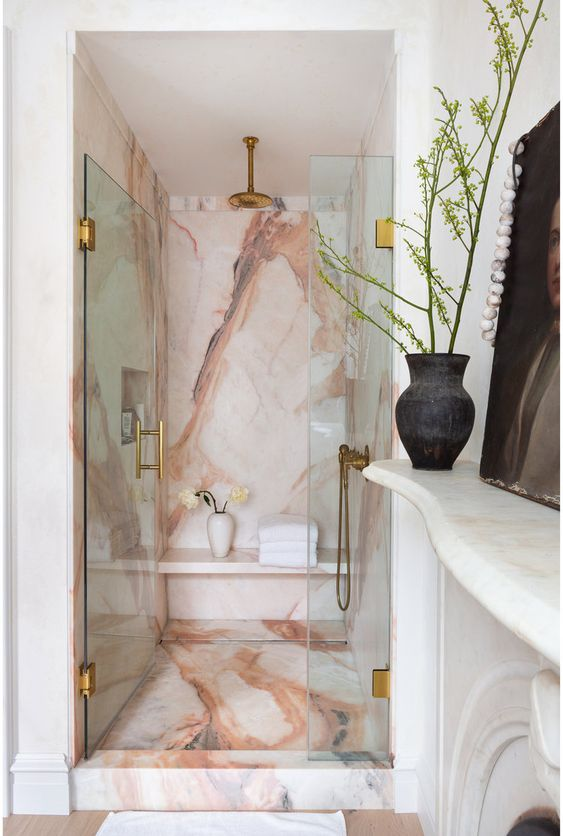 pink calacatta marble sheethes the bathroom walls in the home of eyeswoon's athena calderone.