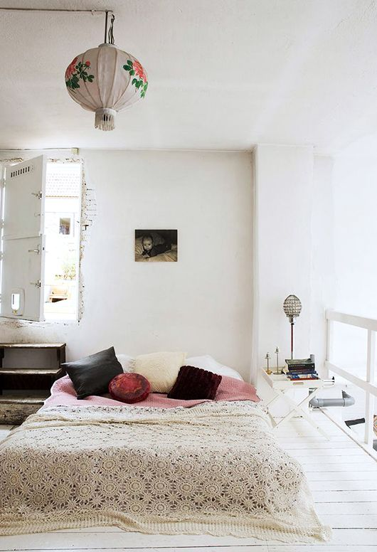 pared back minimalist spring decor. a bedroom with soft shades of pink and white walls