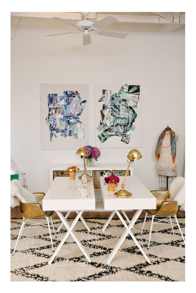This iconic glam black white and gold dining room feature a bold beni ourain rug, a pair of herman miller chairs a white laquered table. So simple so stand out interior design, styled with a vase of pink red flowers to top.