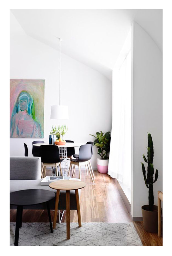 Soft color in Danish interior design is fresh as it gets. A carefully chosen piece of art, a simple beni ourain rug, herman miller chairs. Scandinavian elegance.