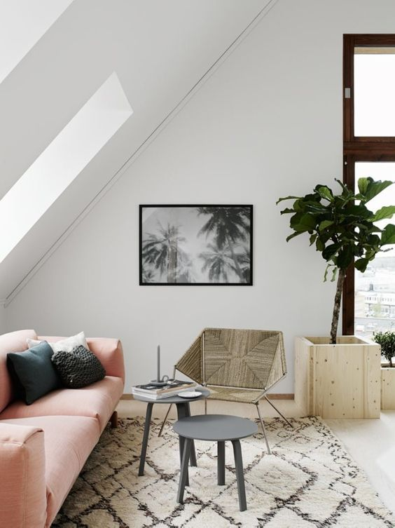 how to decorate with pink: a blush pink sofa and beni ourain in a Scandinavian minimalist home in Denmark.