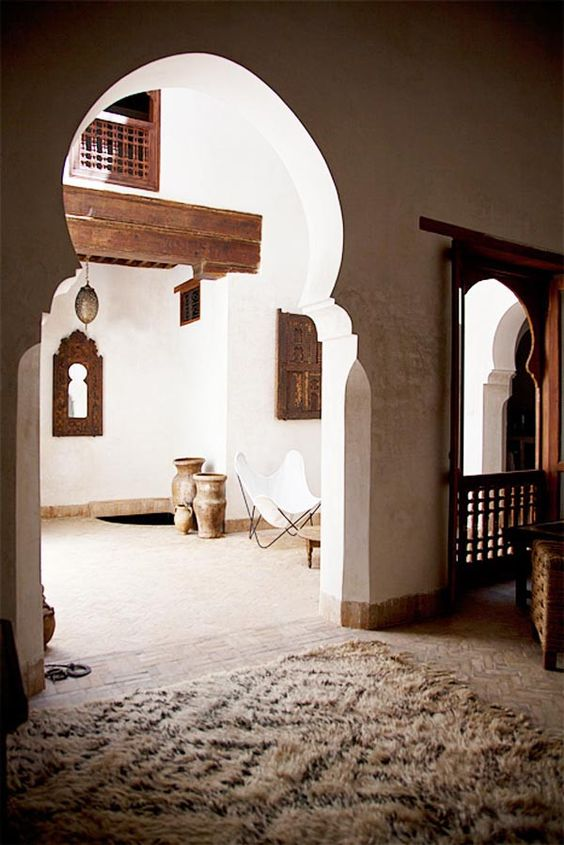 beautiful room with beni ourain: islamic art deco arches in a riad in Marrakesh, and a classic beni ourain