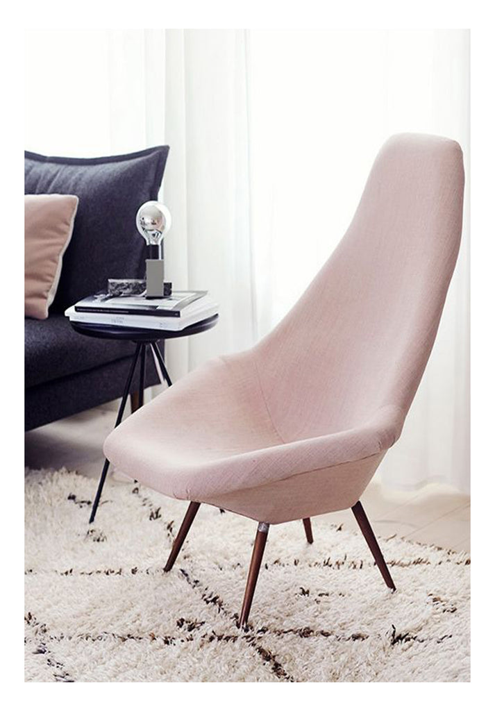 Contemporary Danish design is furniture art. Add blush pink upholstery and the look is surprisingly avant garde. Anchor the design with large scale pattern Beni Ourain which complements the graceful angles of the furniture, and you've got iconic modern style.