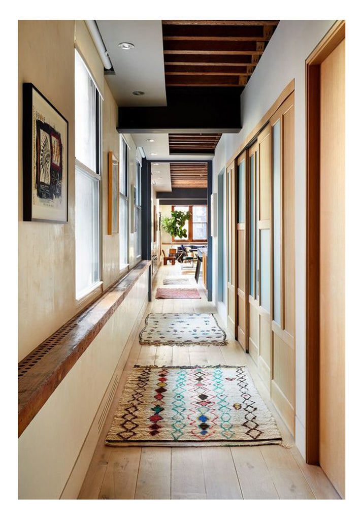 The kitchen, entry, and dining room are all areas with high foot traffic. A durable rug that is going to last is what you are looking for here. A low, dense hand knotted pile or flat weave are good choices.  In this California modern home, a collection of playful Moroccan boucherouite rugs in soft muted pastels line the hallway, setting the tone for artful and refreshing modern design.