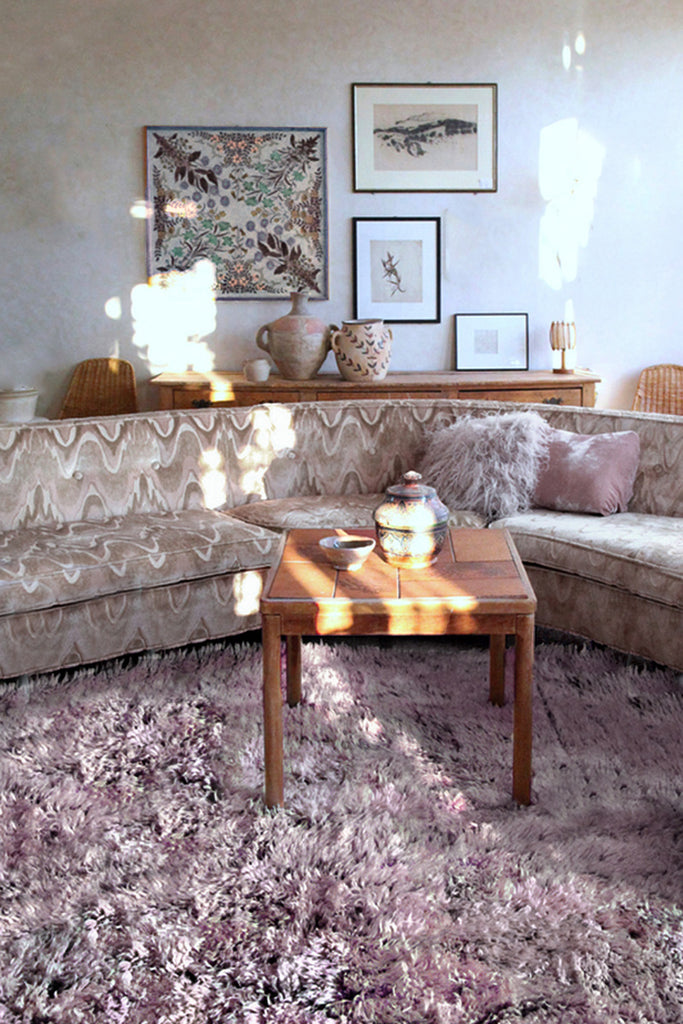 a pink beni mguild rug surrounded by chic mid century furniture, at the gardener's house