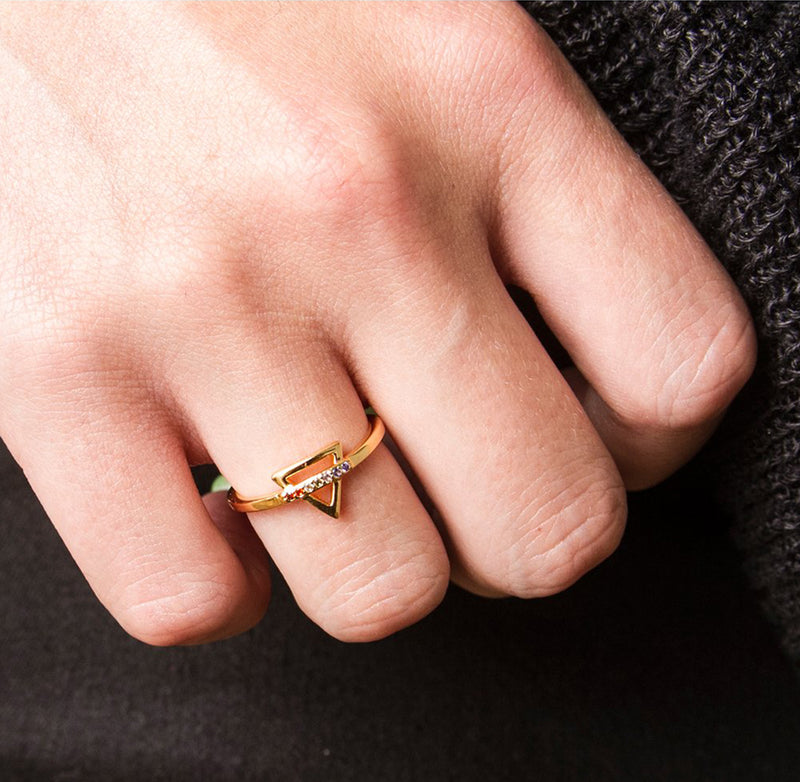 Adjustable knuckle ring with Chakra colors finished in yellow gold.
