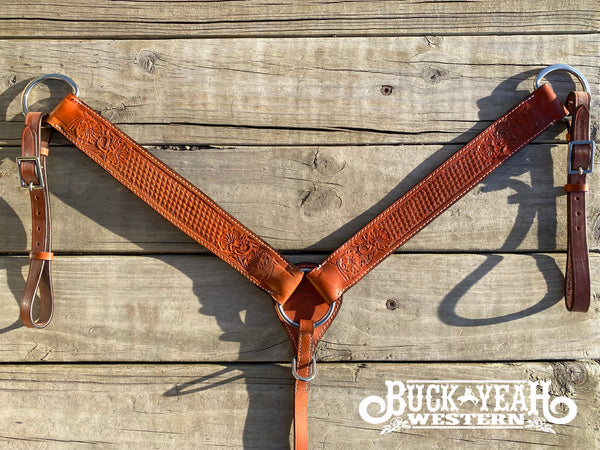 Leather breastcollar has floral and basketweave tooling