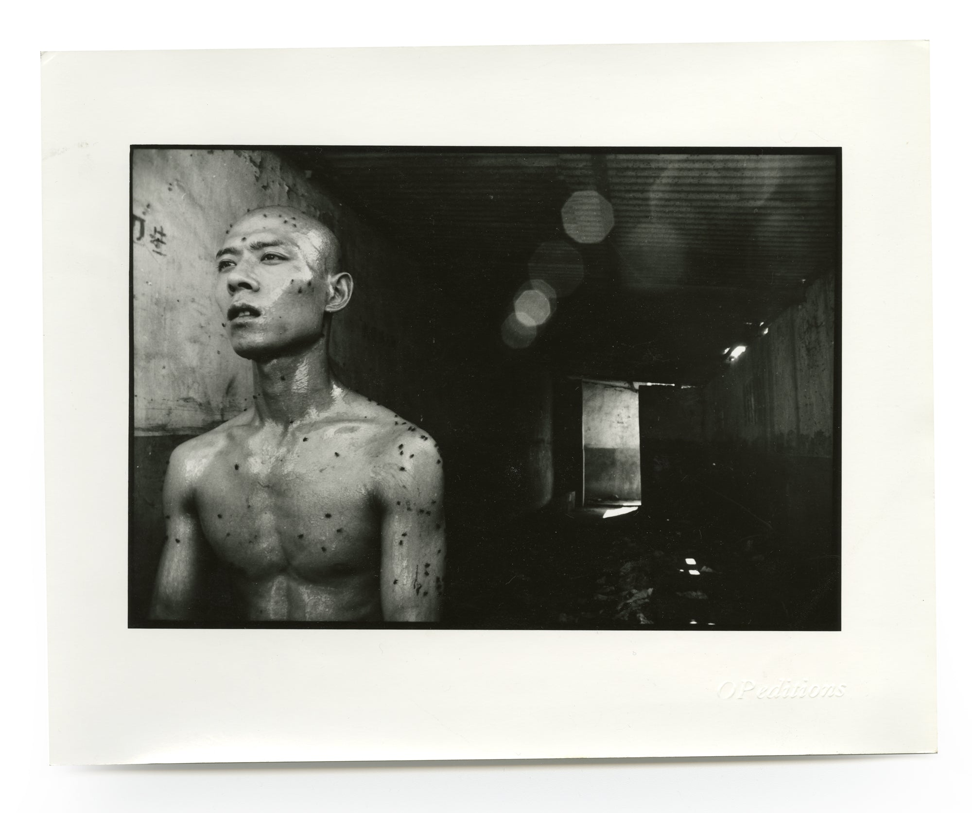 "Zhang Huan in the performance ""12 Square Meters"""