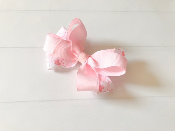 Girls Double Twisted Valentine Heart Boutique Hair Bow - The Enchanted Magnolia