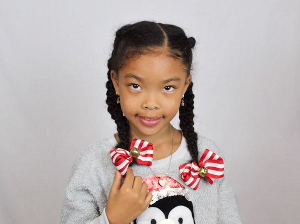 Model wearing Jingle Bell Hair Bows - The Enchanted Magnolia