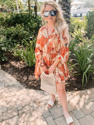 orange printed dress with accessories