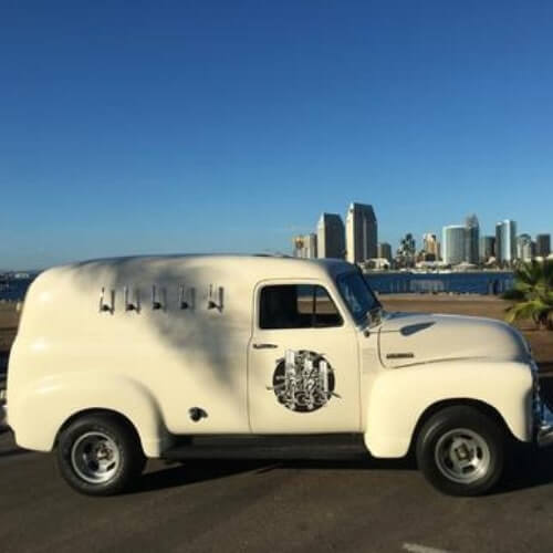 '52 Chevy Panel Truck. Classic white truck with city views and blue skies