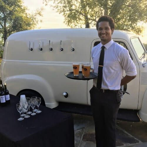 Profession mobile bartender with draft beers on serving tray