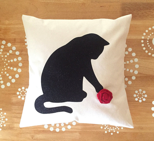black cat pillow cover with red rosette