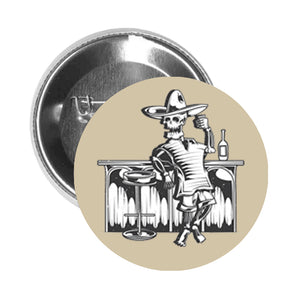 Round Pinback Button Pin Brooch Skull Standing at Bar Poncho Sombrero Drink Alcohol Tequila Cocktail Pub Cartoon - Beige