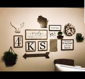 Gallery wall featuring some of our most popular handmade wood signs