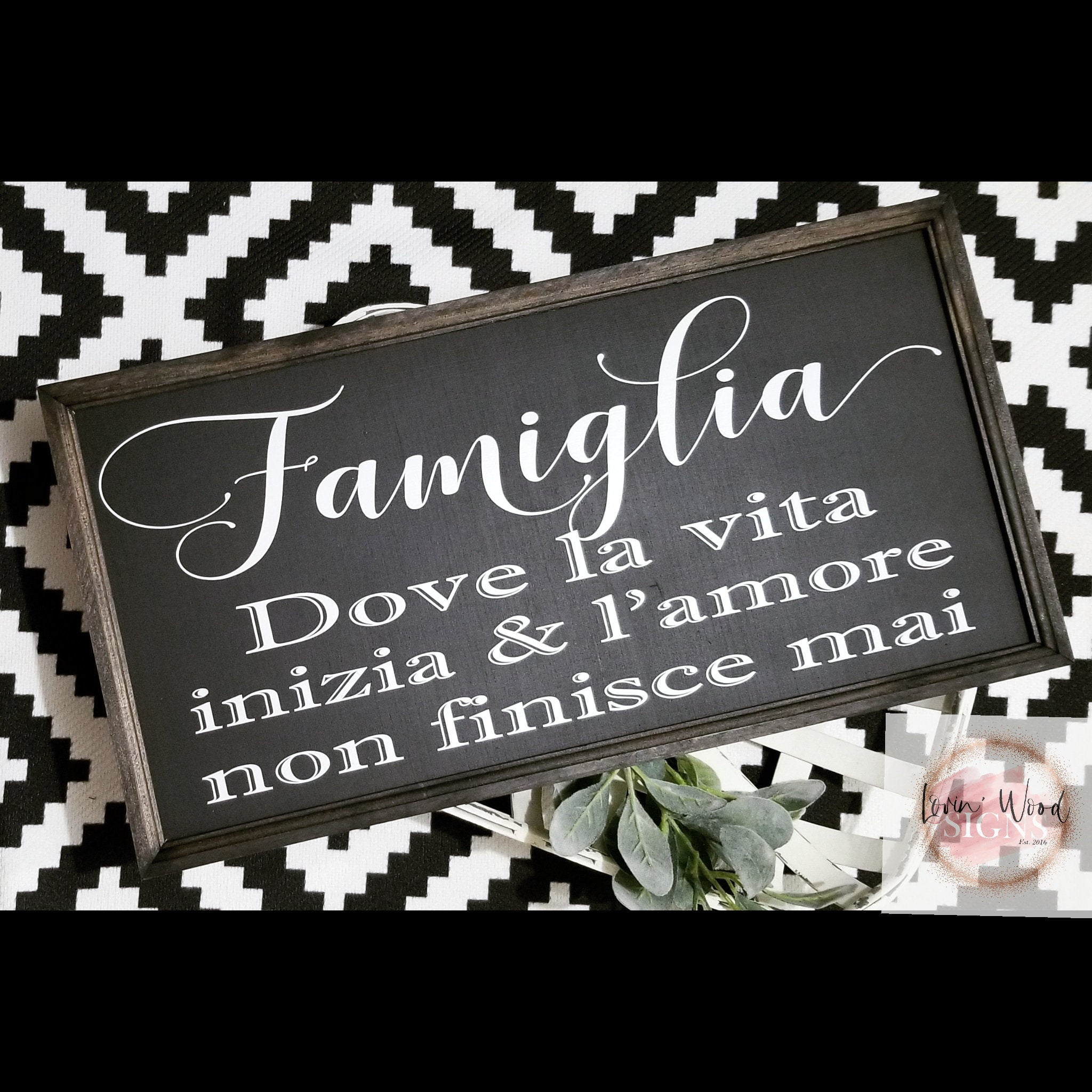 Famiglia sign, where life begins and love never ends sign