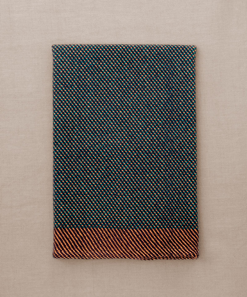 Orange and green handwoven towel for the bath or kitchen, made with American cotton.