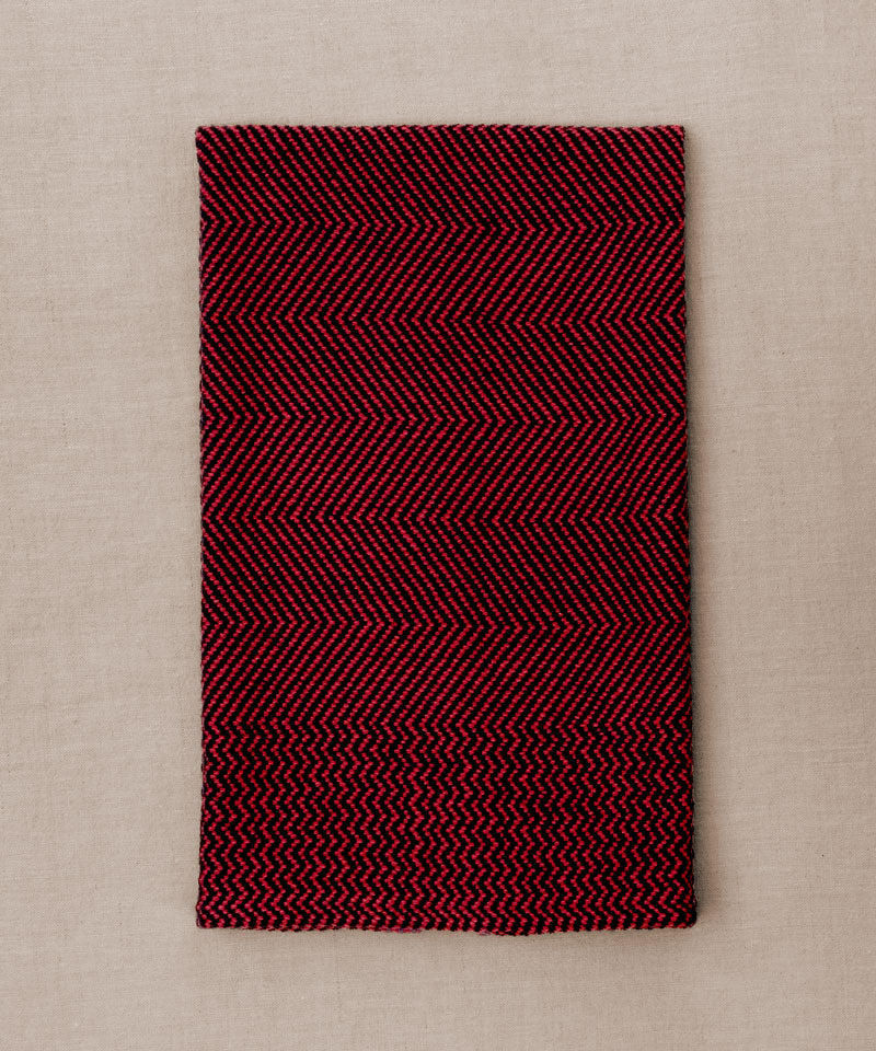 Red and navy handwoven towel for the bath or kitchen, made with American cotton.