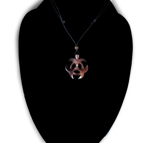 biohazard wooden pendant Ayu Tribal Jewelry