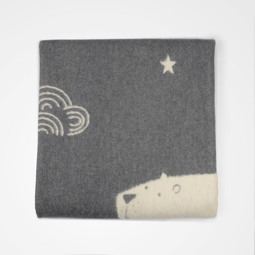 Polar under the night sky cot blanket - grey, by David Fussenegger. Folded view.