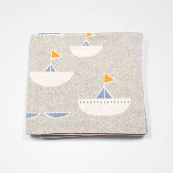 Child or baby blanket with modern boat design. Neutral toned.