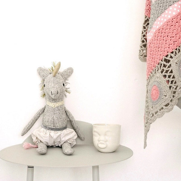 And the little dog laughed - Alice the Unicorn soft toy is a quirky and lovable companion for any child.