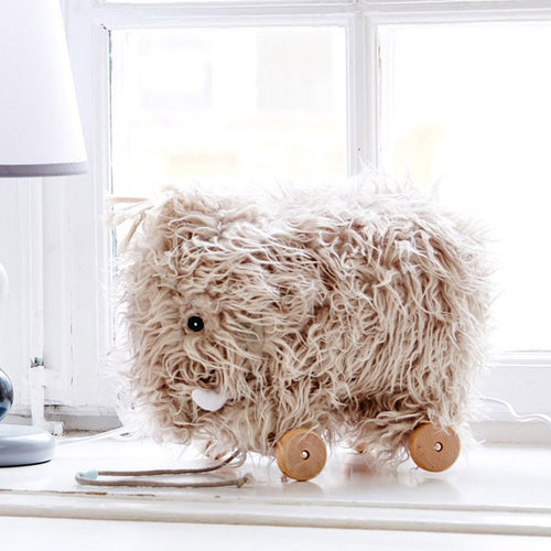 Soft Scandi designed pull toy of a mammoth will be a great companion for your child.