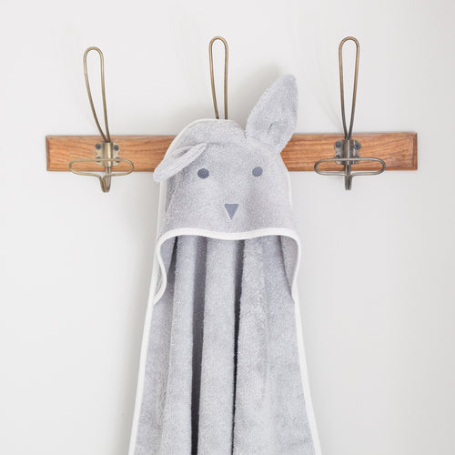 Grey hooded bunny towel hanging on hook.