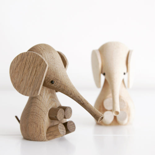 Baby elephants made from smoked oak and rubber wood are a modern nursery feature.