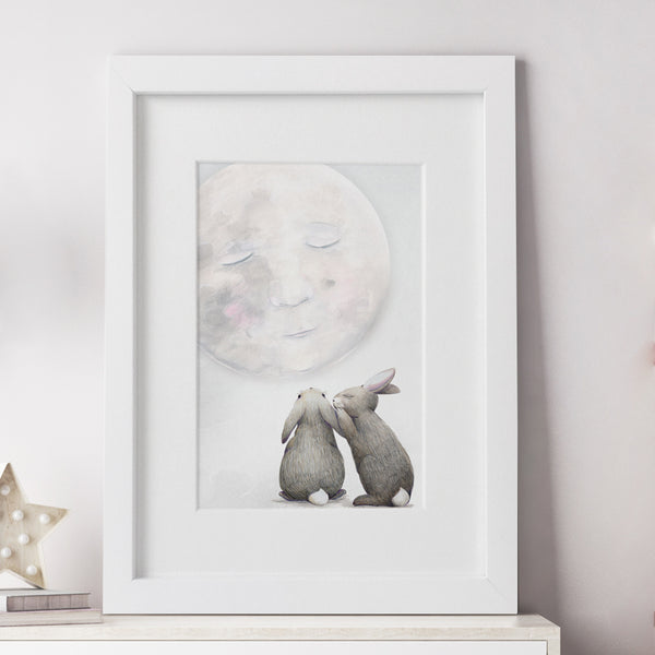 Framed Moon Rabbits Nursery Print by Winter Avenue Press.