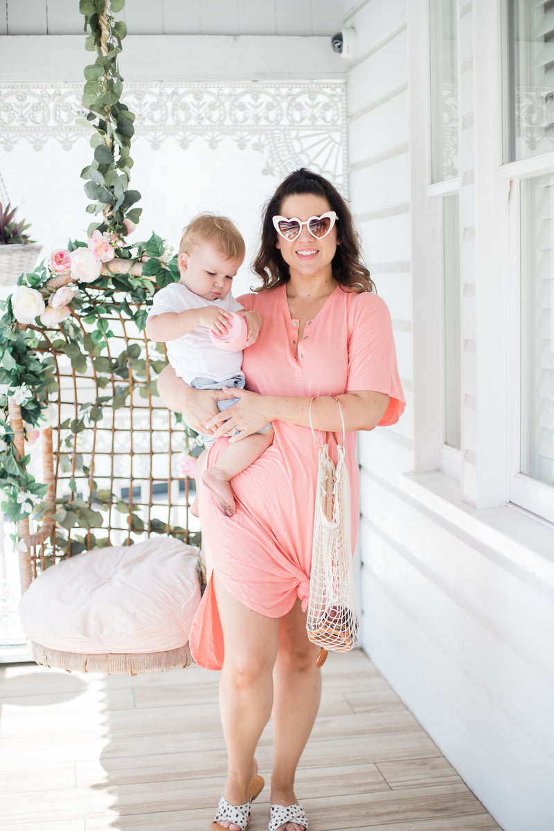 The Comfort Mama dresses for pregnancy,  labour, breastfeeding and beyond. Tilly coral dress.