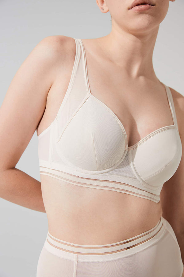 Opaak Chloe underwire spacer bra in light beige (bleached sand), front view shown on model