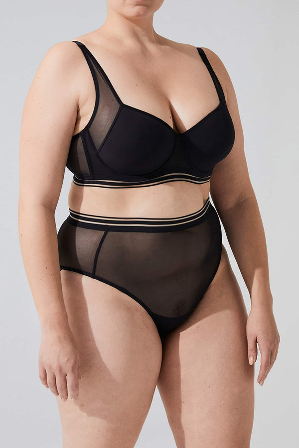 Opaak Paloma high waist brief in sheer black mesh, front/side view, on model