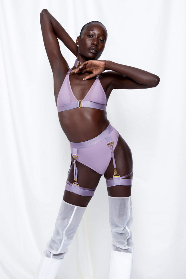 Bordelle Rey high waist thong with suspenders in purple gray (tundra), shown on model in matching garters and bra, front view