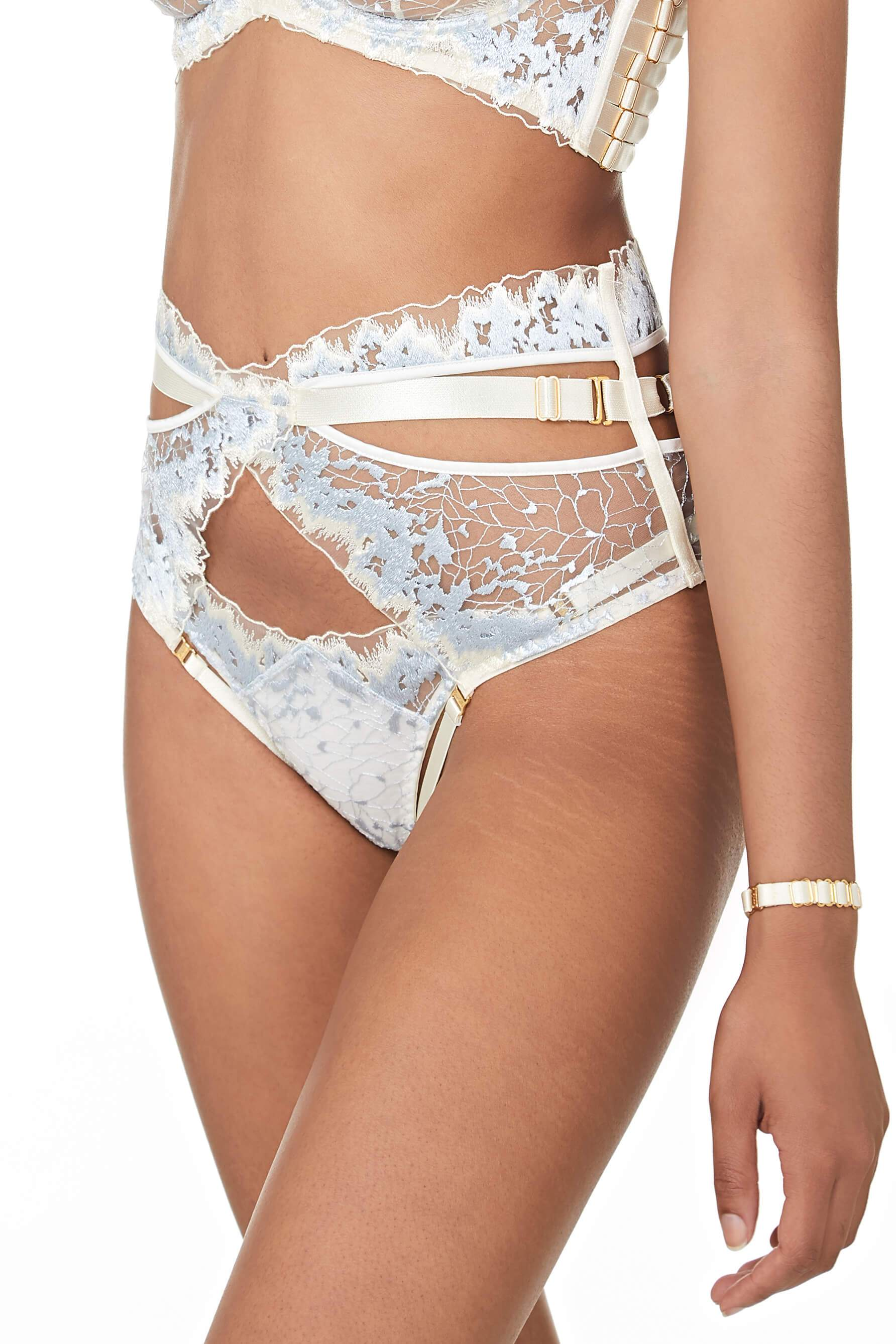 Bordelle Wilde High Waist Ouvert Brief and Thong in cream and black, on model, 3/4 side view