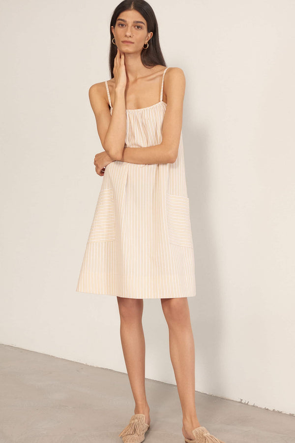 Else Hamptons Slip Dress in flax, clay, and white striped cotton, front view on model