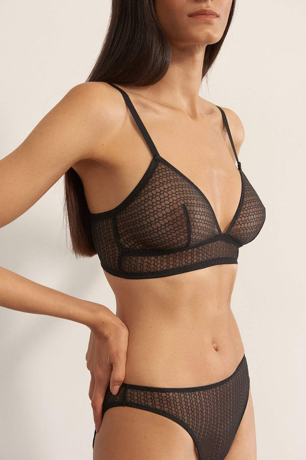 Else Honeycomb triangle wire free bralette in sheer black lace, side view on model