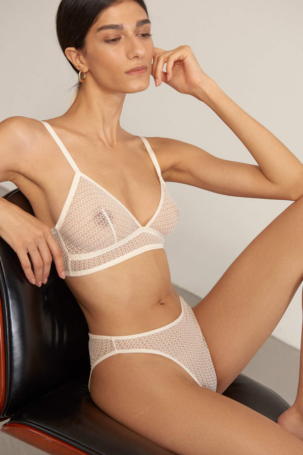 Else Honeycomb bralette and brief in off white mastic sheer lace, side view, on model