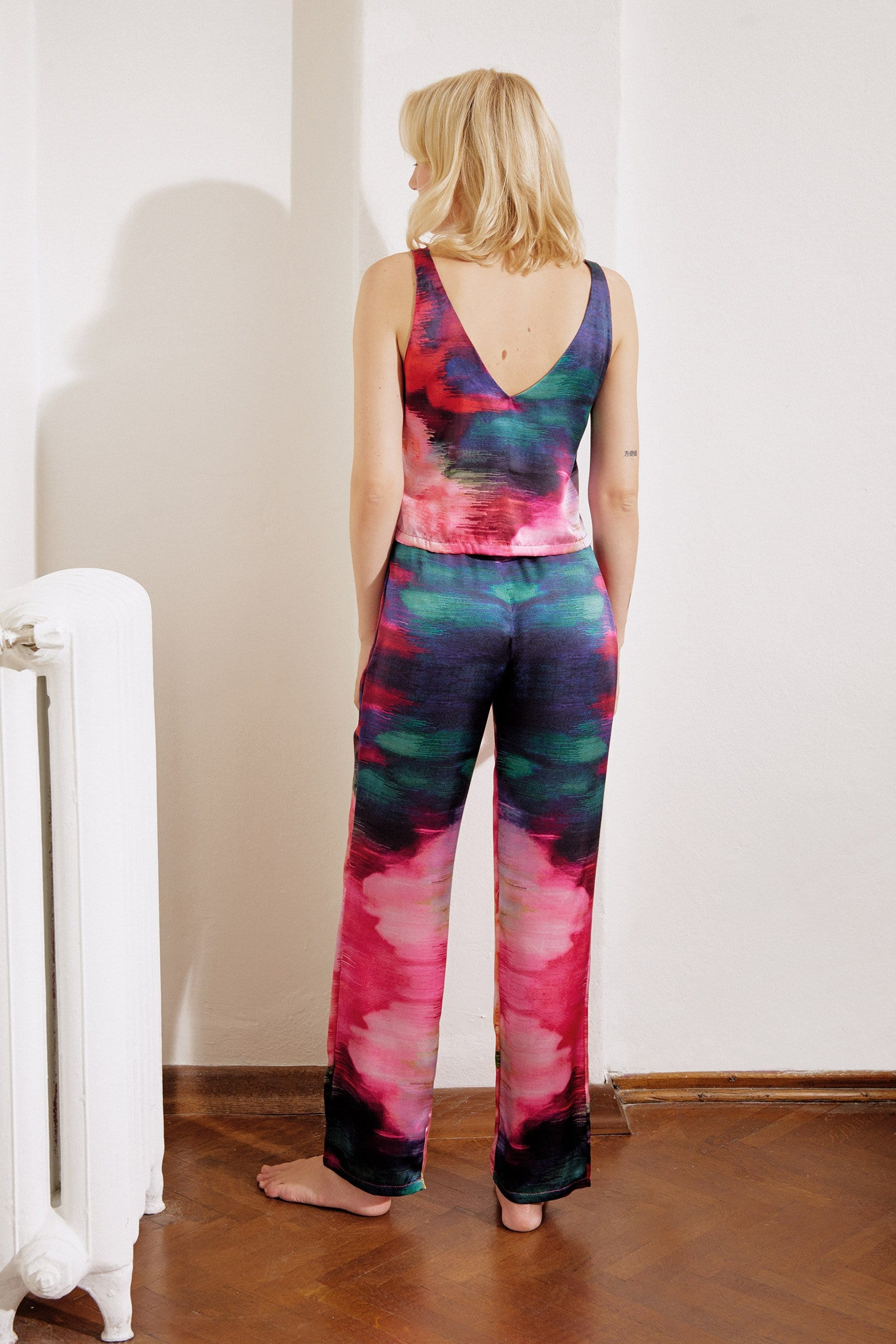 Else Maui silk crop top & long pants in abstract colorful print, on model, back view