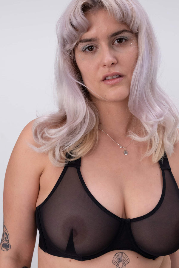 La Fille d'O Baybee underwire balcony bra in sheer black mesh, shown on model, front view.