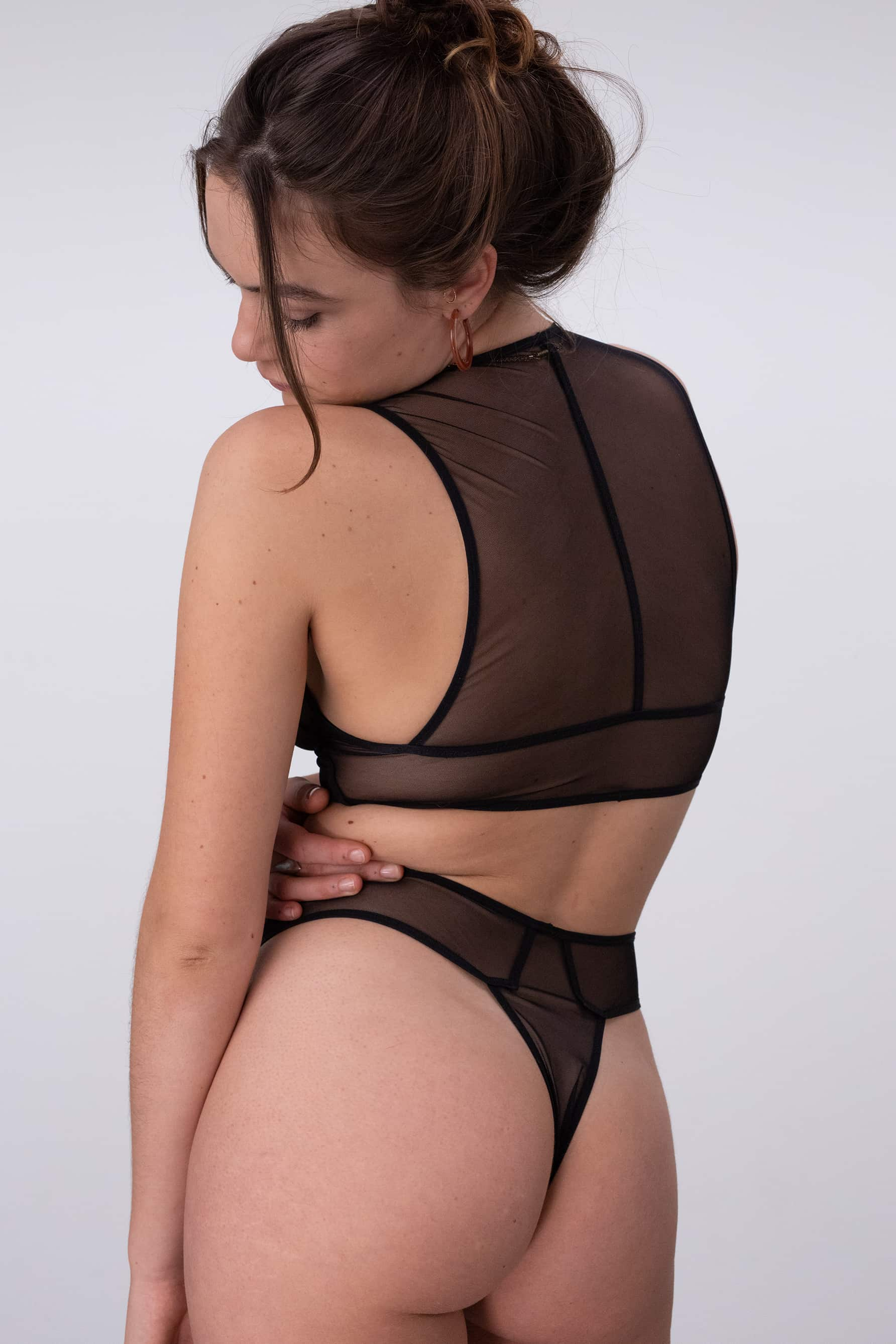 Pierrot sheer black high waist thong by La Fille d'O, back/side view, shown on model