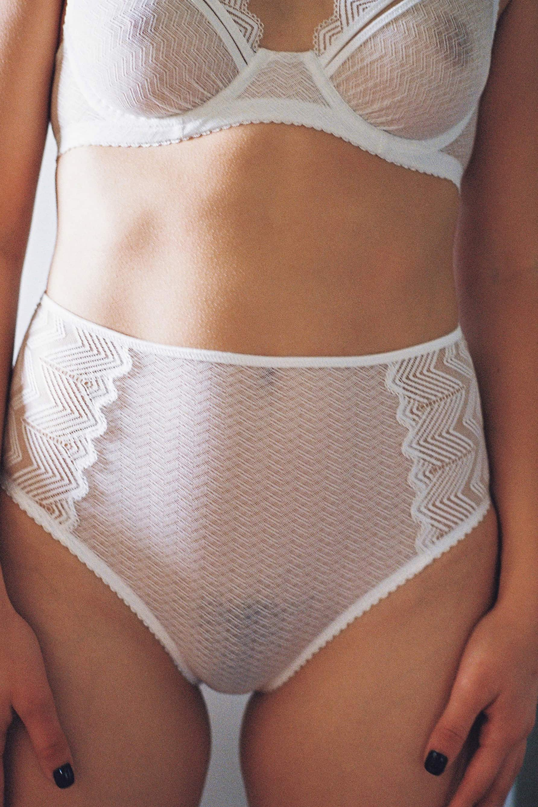 Lonely Misha High Waist Brief in sheer white lace, front view, on model in matching underwire bra